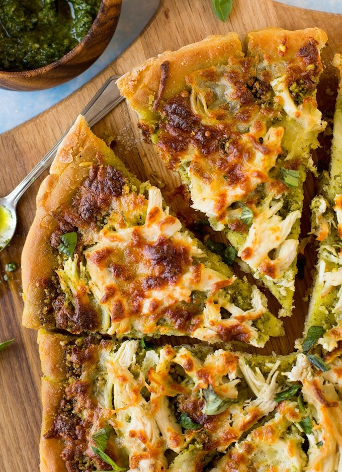 Low FODMAP Chicken Pesto Pizza - topped with a simple chive pesto, shredded chicken breasts and mozzarella. | Gluten Free + FODMAP Friendly