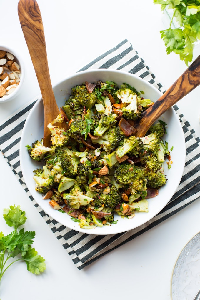 Crispy, crunchy Roasted Broccoli Salad tossed in a simple garlic-chilli dressing and mixed with roughly chopped almonds and salty bacon pieces. Gluten Free + Paleo + Whole30