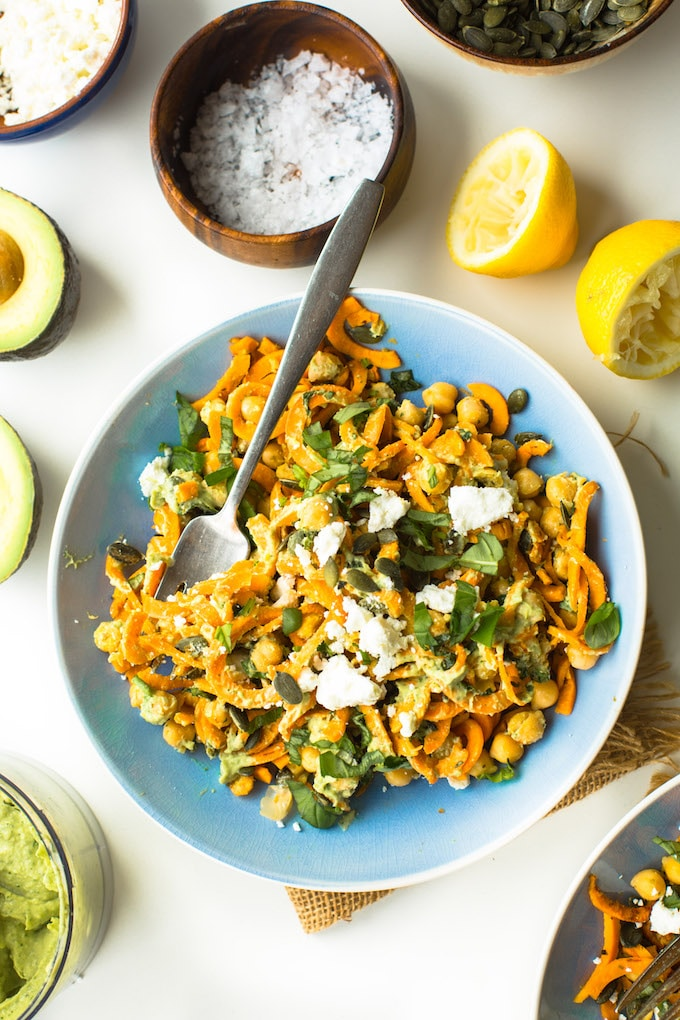 Spiralized Sweet Potato Noodles tossed in simple avocado tahini sauce, mixed with chickpeas, fresh basil and top with feta | Gluten Free + Grain Free + Vegan Option