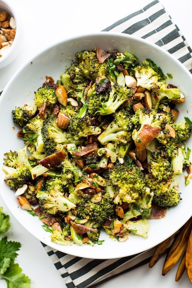 Garlic & Chili Roasted Broccoli Salad in a bowl on a stripped napkin