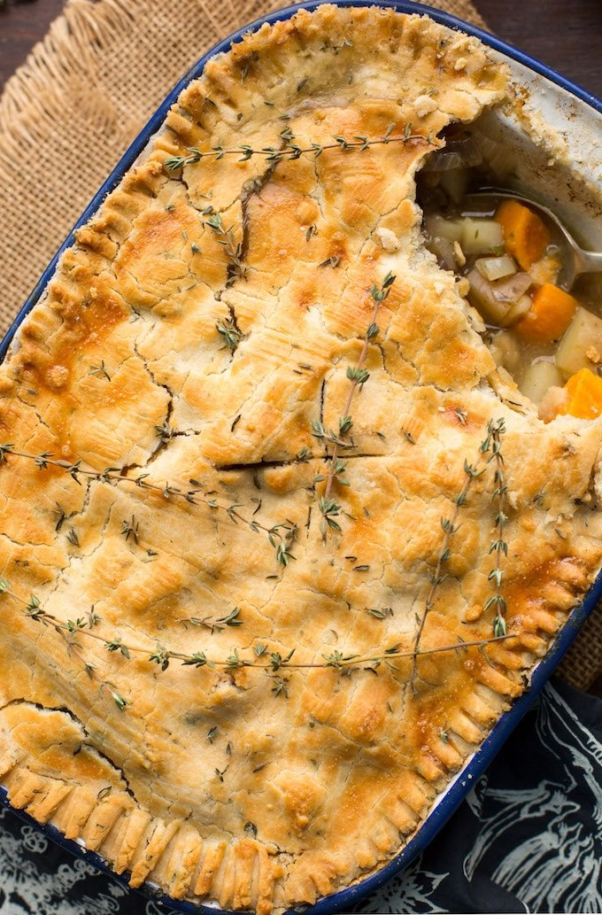 Lightened up Gluten Free Chicken Pot Pie loaded with veggies & topped with an herby crust | Dairy Free Option Available