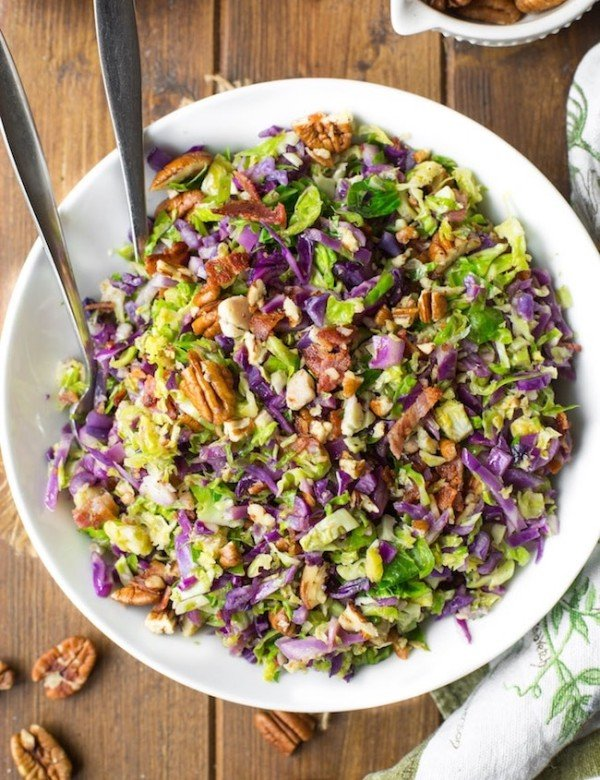 Bacon Brussels & Cabbage Salad in a serving bowl with tongs
