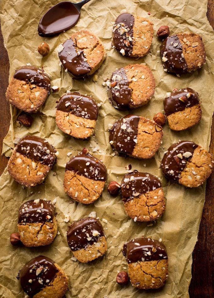 Chocolate and Hazelnut Slice and Bake Cookies - crunchy, toasted hazelnut cookies dipped in dark chocolate | Grain Free + Vegan