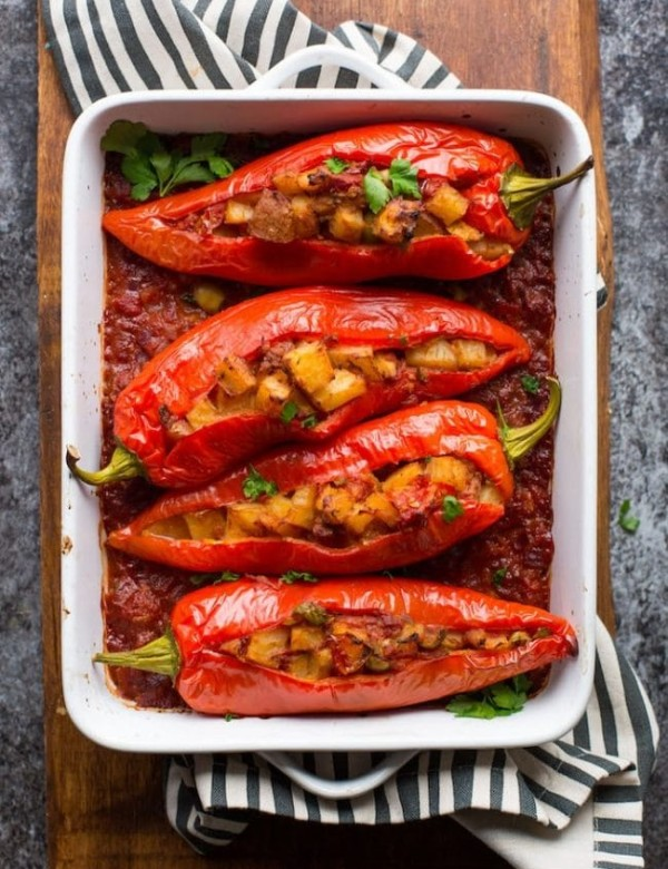 Potato and Olive Stuffed Banana Peppers cooked on a cutting board