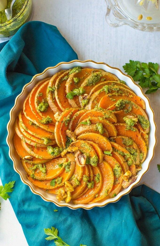 Tender roasted butternut squash slices with a simple parsley pesto and topped with pieces of walnut for added crunch! Gluten Free + Vegan + Whole30 | Final dish