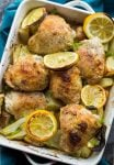 Simple, Roasted Lemon & Fennel Chicken Thighs with potatoes in a baking dish