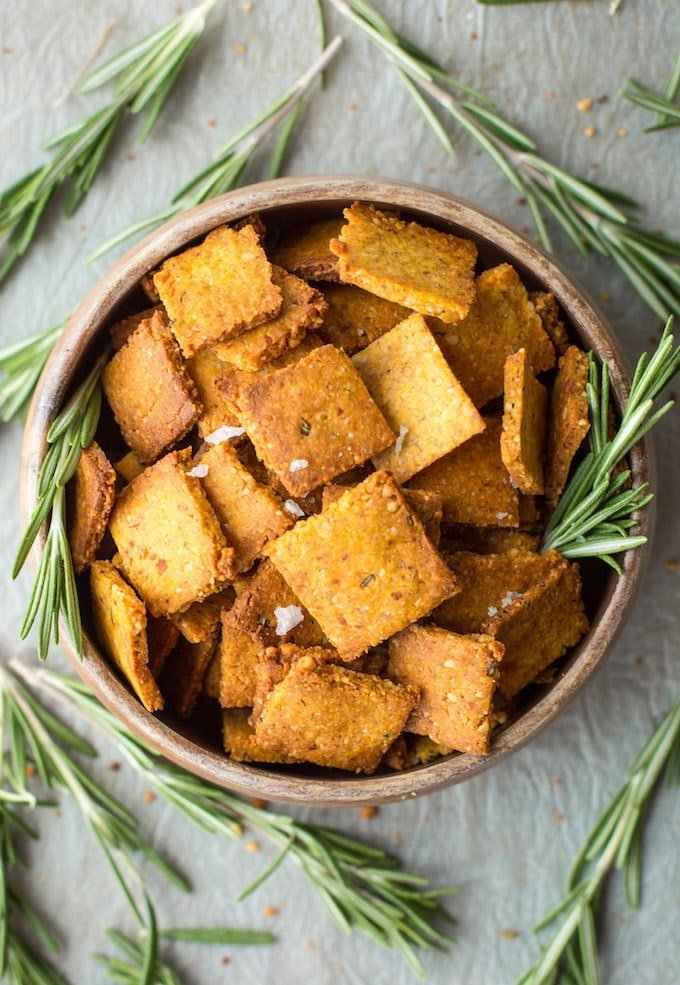 Complete your next snack board with these  Sweet Potato Paleo Crackers - only 7 ingredients needed & easy to make! |Grain Free + Vegan | Bowl of crackers from above