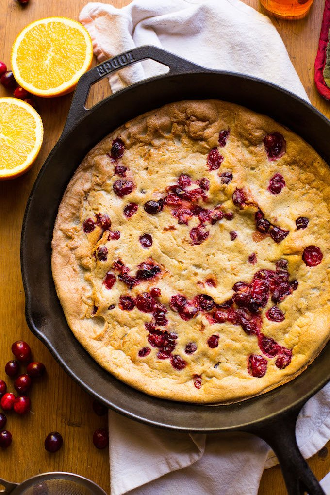 Grain free Cranberry Orange Dutch Baby - sweet, tangy, and perfectly spiced! Perfect for holiday breakfasts & brunches | Dairy Free + Refined Sugar Free