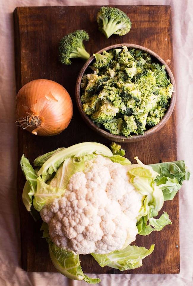a head of cauliflower, broccoli and onion