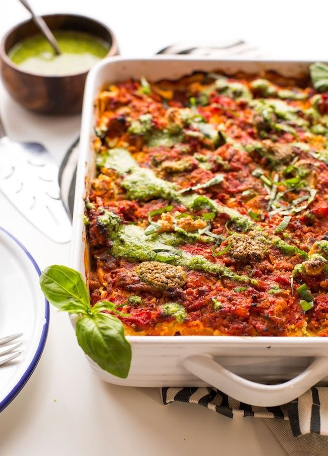 Paleo Sweet Potato Lasagna with basil pesto drizzled over the top and fresh basil garnishes