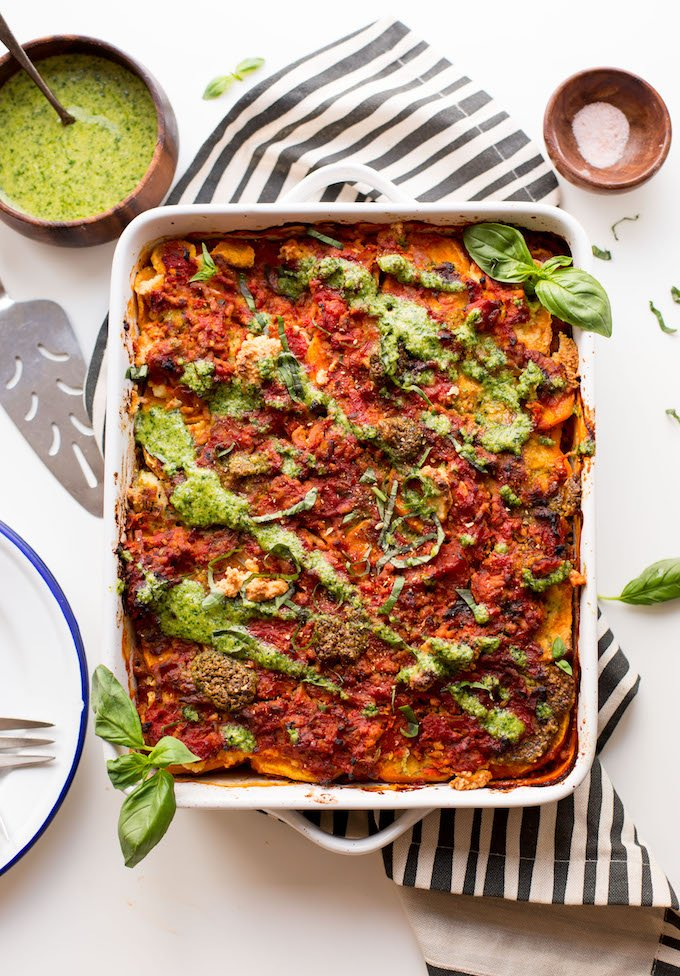 Paleo Sweet Potato Lasagna with a basil pesto drizzled over the top