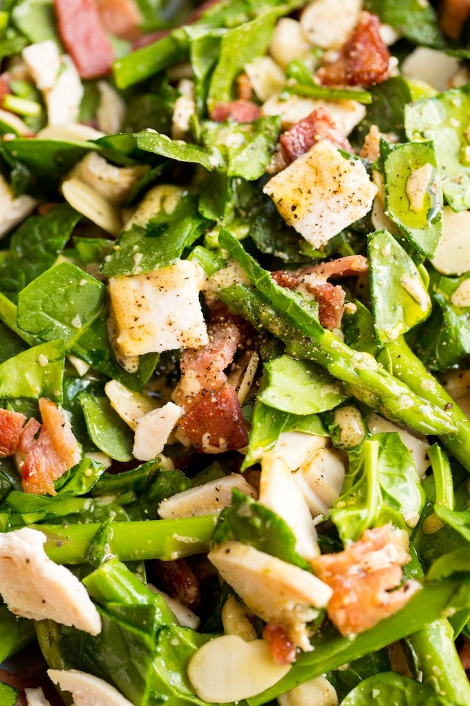 Chicken Bacon Spinach and Asparagus Salad up close and dressed in vinaigrette