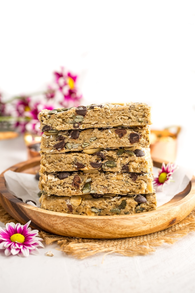 Peanut Butter No Bake Granola Bars stacked on a plate #glutenfree #vegan