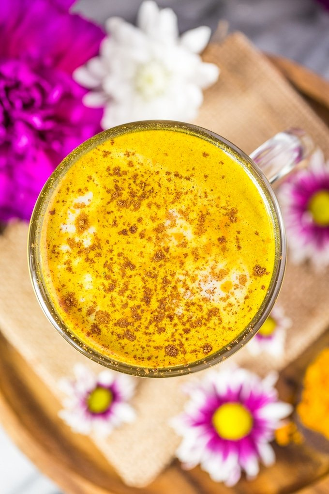 Golden Turmeric Latte with cinnamon sprinkled over the top - view from the top down #glutenfree + #vegan + #paleo