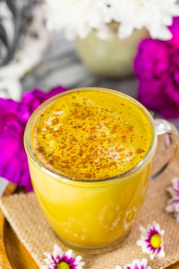 Golden Turmeric Latte on a plate #glutenfree #vegan #goldenmilk