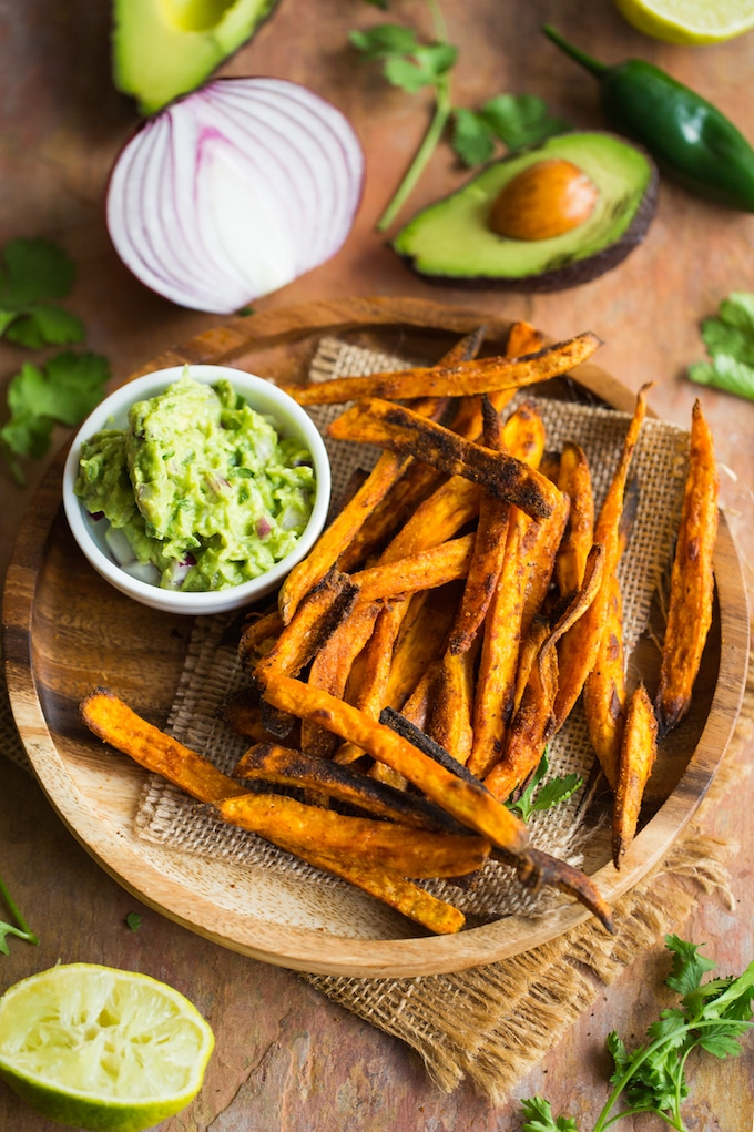 Crispy Baked Sweet Potato Fries on a plate with a side of guacamole
