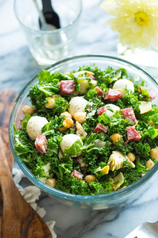 Chickpea Kale Antipasto Salad in a salad bowl on a marble counter