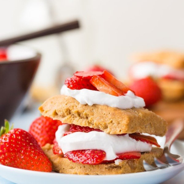 Gluten Free Vegan Strawberry Shortcake with coconut whipped cream and fresh berries presented on a plate