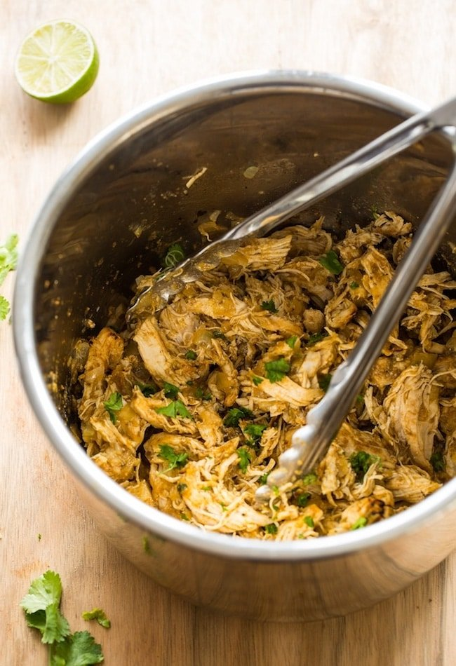 Instant Pot Chicken Carnitas - shredded chicken in the instant pot topped with fresh cilantro