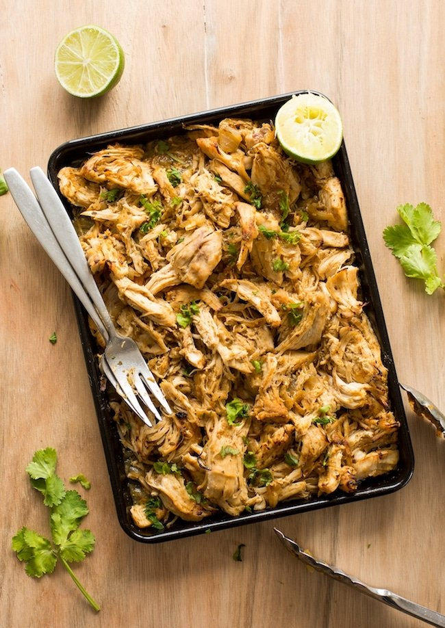 Instant Pot Chicken Carnitas shredded on a baking sheet with forks