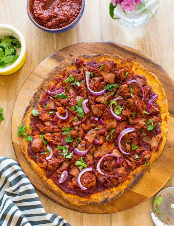 sliced Jackfruit BBQ Pizza with a Sweet Potato Crust on a serving tray and topped with fresh cilantro