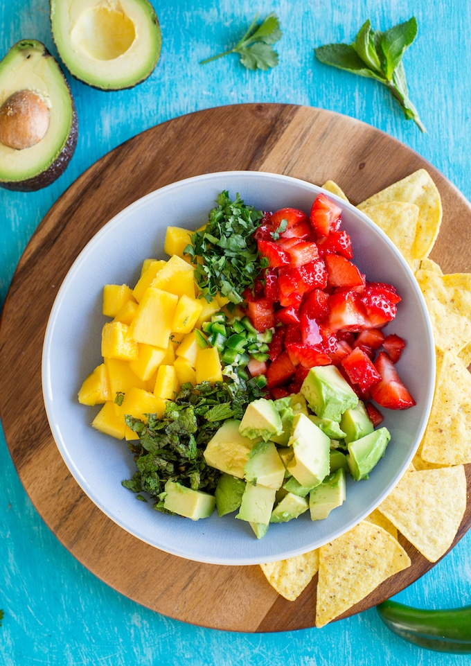 Avocado Strawberry Mango Salsa ingredients in a bowl before before mixed together