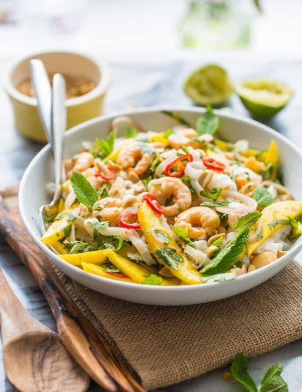 Spicy Mango & Shrimp Thai Noodle Salad tossed in a bowl with forks