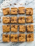 Paleo Vegan Blondies cut into squares on a marble counter