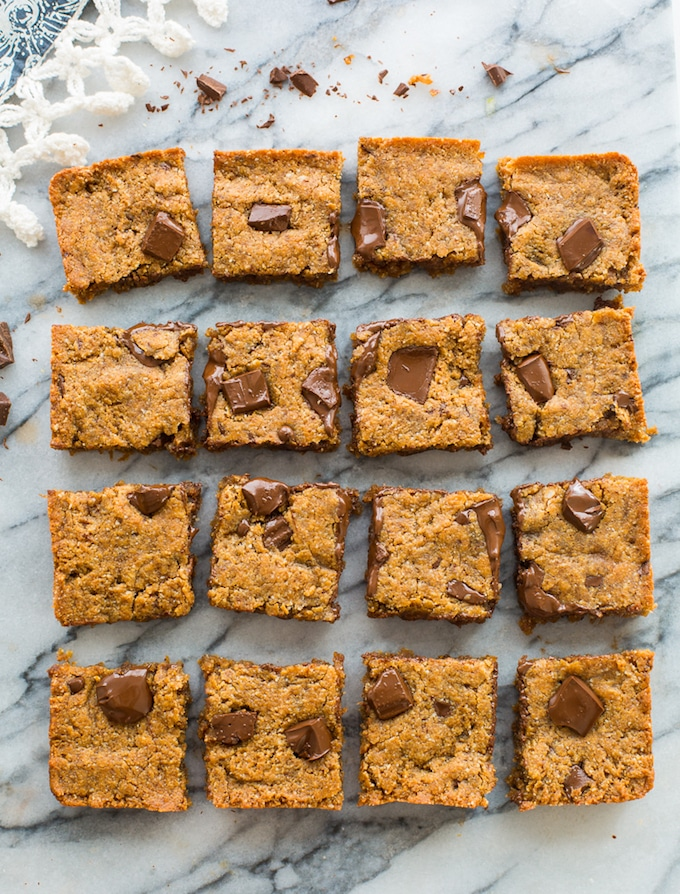 Paleo Almond Butter vegan Blondies cut into squares on a marble counter