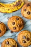 paleo banana muffins with chocolate chips on a marble surface