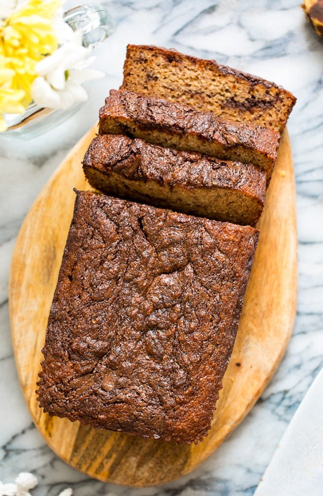 paleo banana bread on a cutting board with slices