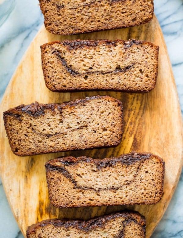paleo banana bread slices showing off the cinnamon chocolate swirly inside