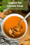 tomato soup in a bowl with croutons and the name: Instant Pot Tomato Soup'