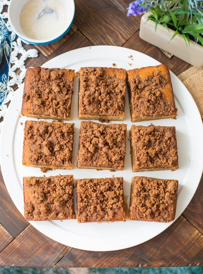 paleo coffee cake cut into squares on a plate