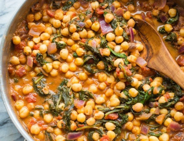 Mediterranean Chickpea Stew with Spinach & Feta in a cooking skillet