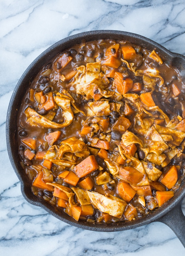 Sweet Potato & Black Bean Enchilada Skillet mixed together in a skillet before added cheese