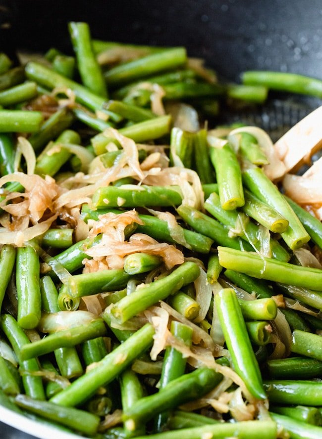 stir fried green beans in a wok