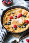 Gluten Free Dutch Baby topped with fresh berries