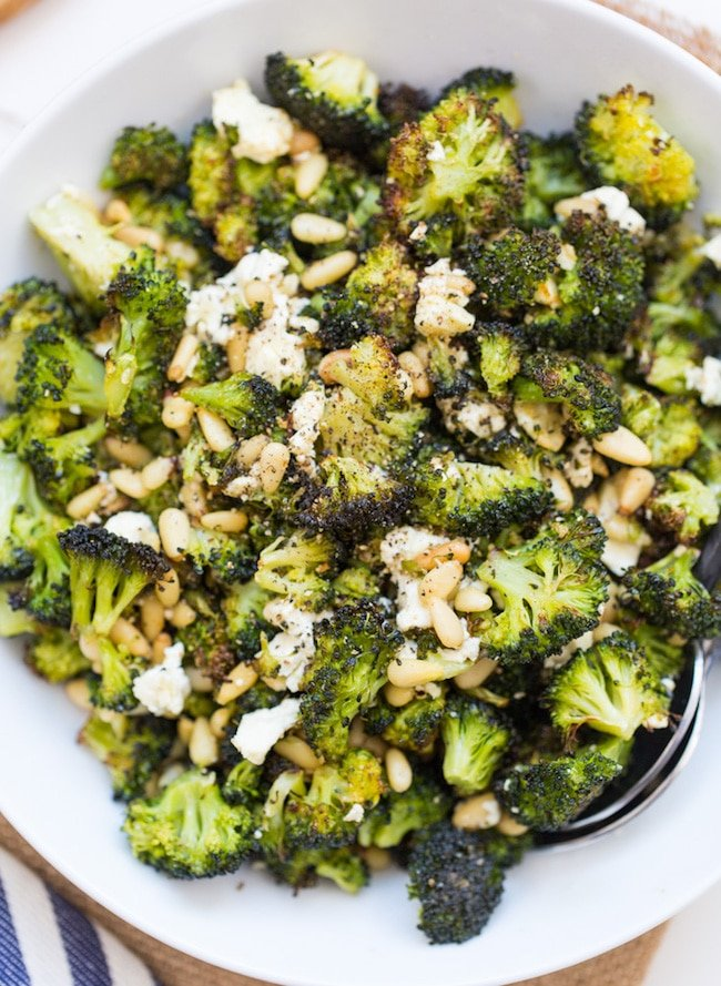 Roasted Broccoli Salad with Feta & Pine nuts up close in a bowl