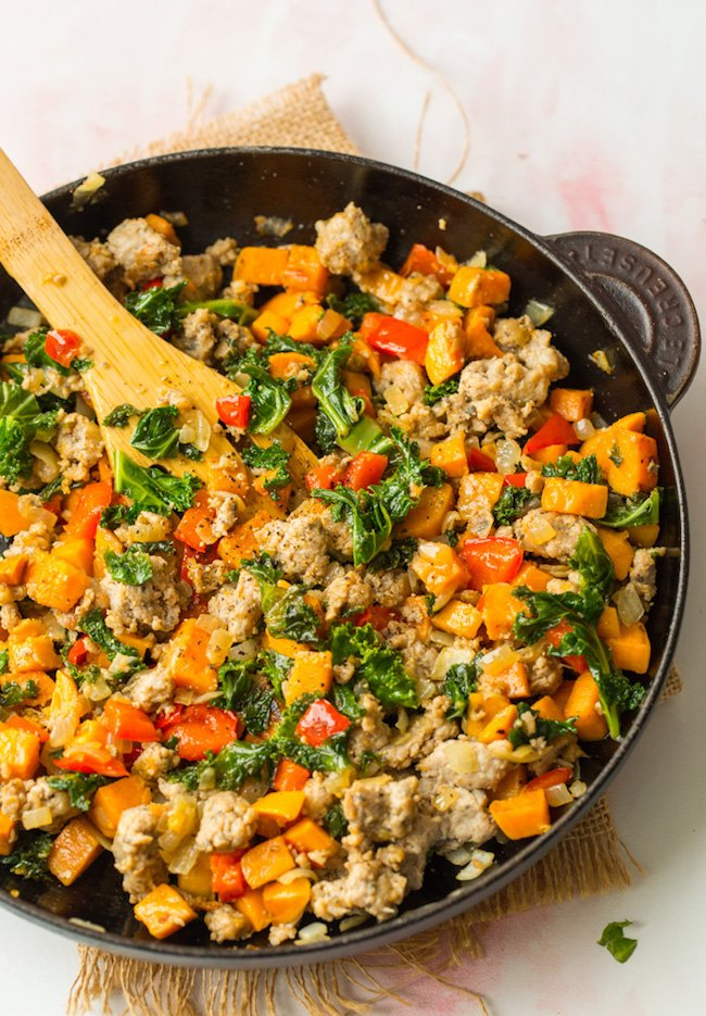 Sausage Kale Sweet Potato Hash in a cast iron skillet
