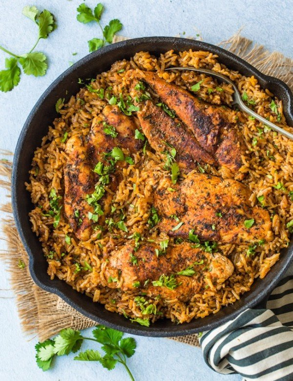one pot chicken and rice in a cast iron skillet