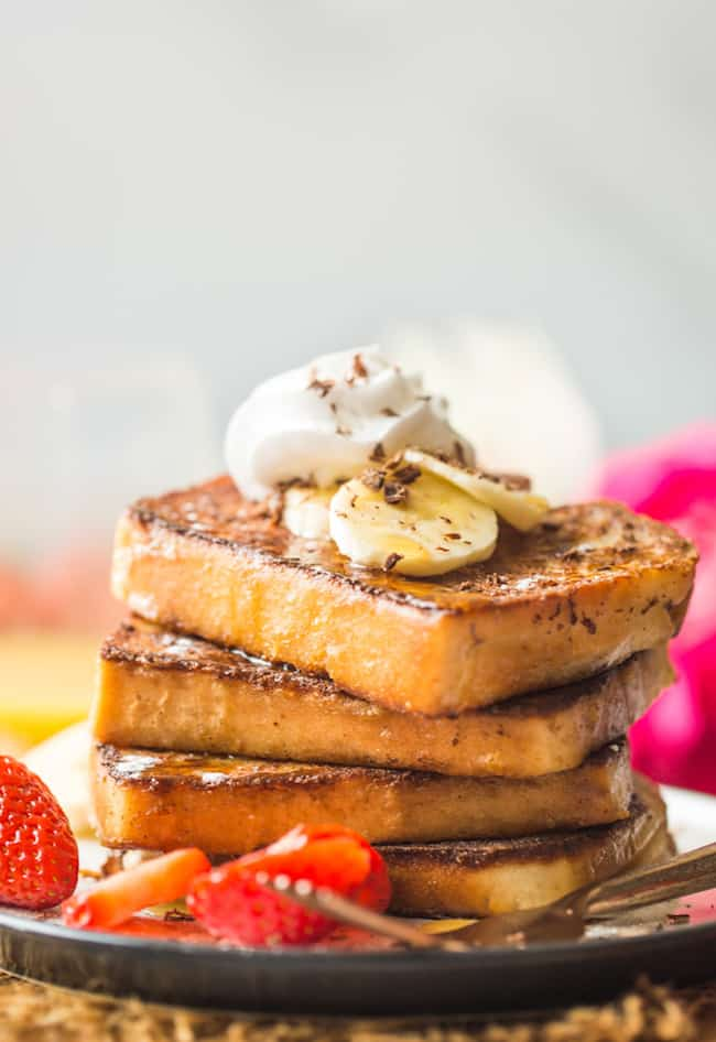 Gluten free french toast stack topped with bananas and whipped cream