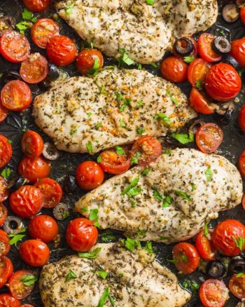 Italian Chicken with Cherry Tomatoes on a baking sheet