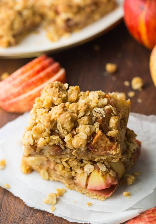 apple crumble bars on a wooden cutting board