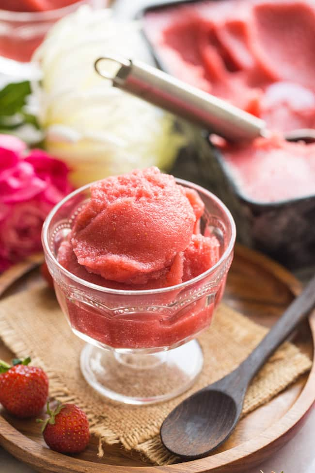 Strawberry Rose Sorbet in a serving glass with strawberries