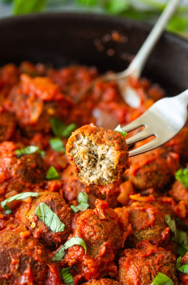 Vegan Lentil Meatballs on a fork with a bite taken out