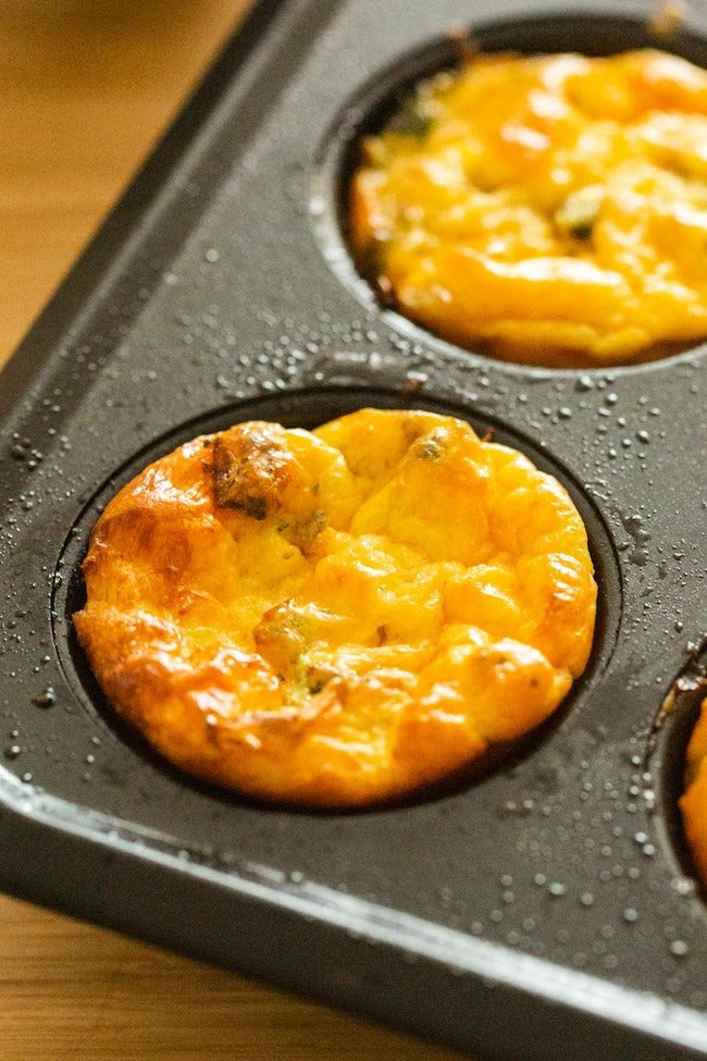Broccoli Cheddar Egg Muffins in a baking tin