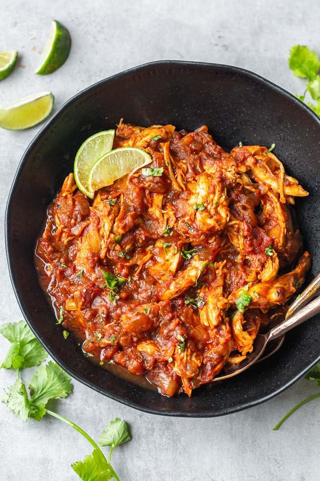 Instant Pot Chicken Tinga in a bowl topping with lime slices