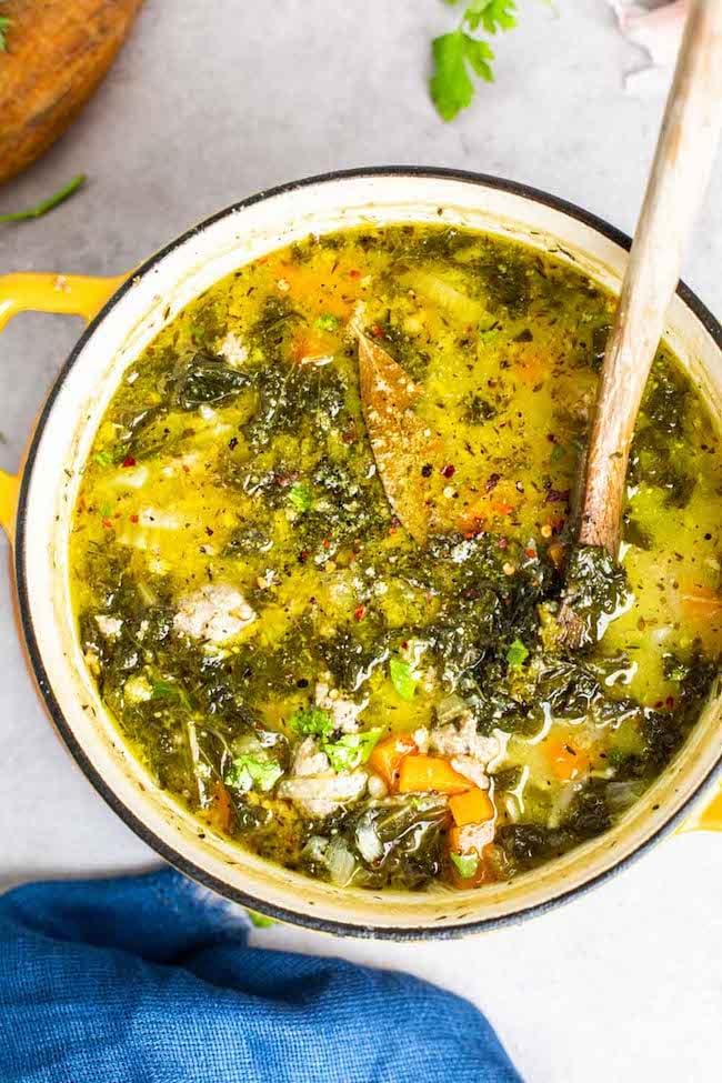 sausage kale soup in a yellow pot