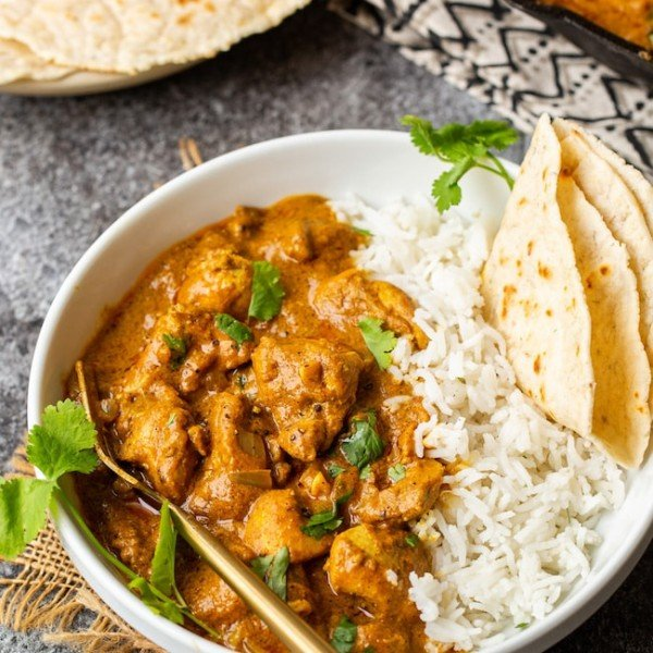 Butter Chicken Pumpkin Curry in a bowl with naan